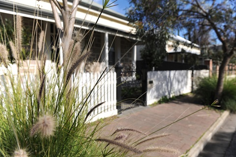 Unley residence facade with picket fence