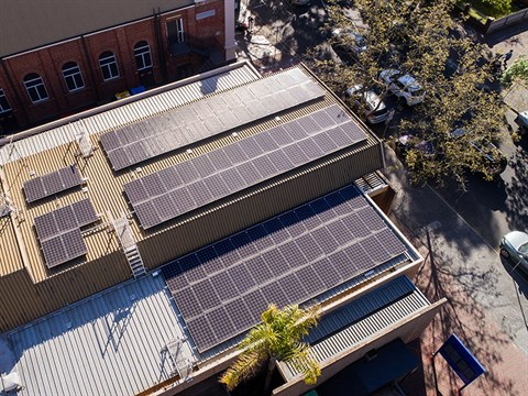 aerial view of solar panels on building roof