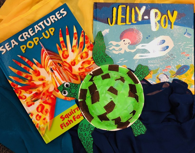 Example of turtle craft made from cardboard and paper, pictured with sea creature books